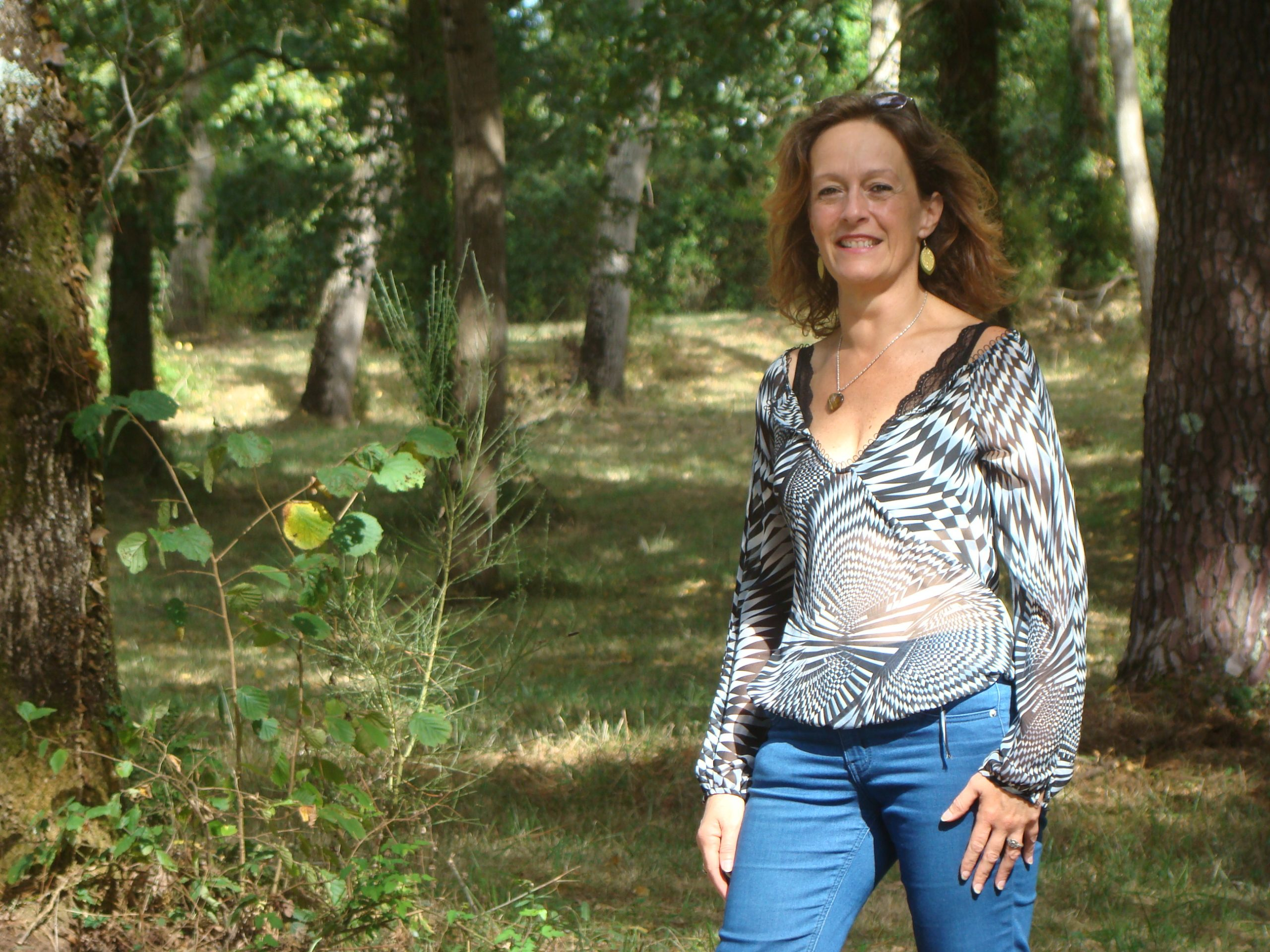 woman standing in a forest